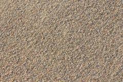 Textura gruesa del fondo de la arena Fotos de archivo libres de regalías