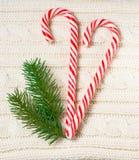 Textura hecha punto de las lanas con la decoración de la Navidad y Imágenes de archivo libres de regalías