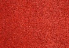 Textura horizontal del fondo rojo de la textura del piso de la pista de despeque Imágenes de archivo libres de regalías