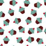Textura inconsútil con las magdalenas del chokolate Imagen de archivo libre de regalías