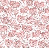 Textura inconsútil con los contornos rojos de los corazones del garabato ilustración del vector