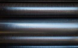 Textura industrial del tubo apilado Fotos de archivo libres de regalías