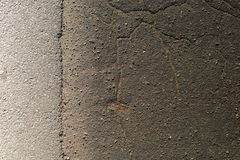 Textura lisa do fundo rachado preto do asfalto imagens de stock royalty free