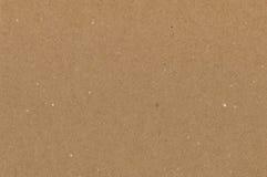 Textura marrón de la cartulina del papel de embalaje, fondo texturizado áspero natural del espacio de la copia, moreno oscuro hor Imagen de archivo libre de regalías