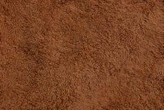 Textura marrón de lana de un pedazo de alfombra Imagen de archivo libre de regalías