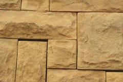 Textura marrón de las tejas de la pared de piedra del Grunge Marrón natural de la pared, anaranjado Imágenes de archivo libres de regalías