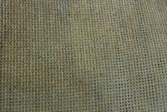 Textura marrón gris de la tela de un pedazo de manta sucia fotos de archivo