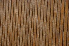Textura marrom cinzenta de placas de madeira velhas de uma cerca rural Imagens de Stock Royalty Free