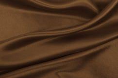 Textura marrom elegante lisa da seda ou do cetim como o fundo abstrato Projeto luxuoso do fundo No sepia tonificado Estilo retro imagem de stock