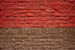 Textura a medias roja y media de la pared de ladrillo de Brown Imagen de archivo libre de regalías