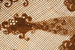 Textura, modelo el cordón de la tela es de oro, pardusco-amarillo Shinni Foto de archivo libre de regalías