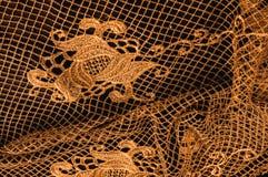 Textura, modelo el cordón de la tela es de oro, pardusco-amarillo Shinni Fotografía de archivo libre de regalías