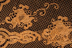 Textura, modelo el cordón de la tela es de oro, pardusco-amarillo Shinni Imágenes de archivo libres de regalías