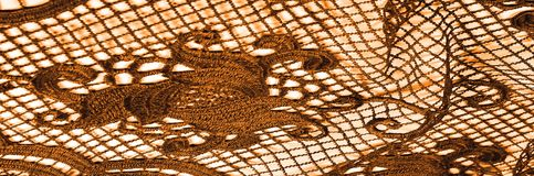 Textura, modelo el cordón de la tela es de oro, pardusco-amarillo Shinni Imagenes de archivo