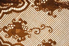 Textura, modelo el cordón de la tela es de oro, pardusco-amarillo Shinni Fotos de archivo libres de regalías