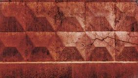Textura muro de cemento rojo con una grieta Imagenes de archivo