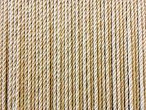 Textura natural de la cuerda, guita beige, arreglo vertical foto de archivo libre de regalías