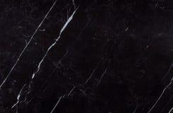 Textura natural del mármol del negro de Nero Marquina del español Foto de archivo