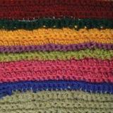 Textura natural hecha punto de las lanas de la ropa del fondo colorido fino de las rayas, amarillo, beige, clarete, rosa, primer  Imagen de archivo