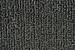Textura negra de la alfombra Foto de archivo libre de regalías