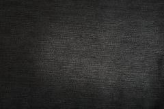 Textura negra de los pantalones vaqueros Foto de archivo