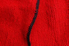Textura negra roja del paño de lana de la ropa Imagen de archivo