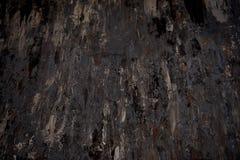 Textura oscura del fondo en colores negros y marrones Movimientos descuidados de la pintura Fotografía de archivo libre de regalías