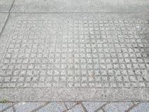 Textura ou teste padrão do retângulo do cimento do cinza no passeio do cimento fotografia de stock royalty free