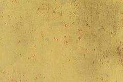 Textura oxidada del metal con los rasgu?os y las grietas rastros de la pintura colores anaranjados sucios Copie el espacio fotos de archivo