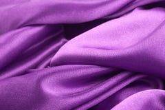 Textura púrpura de la tela Fotos de archivo