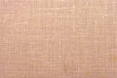 Textura Peach-coloured da tela Imagem de Stock