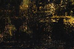 Textura pintada preta do metal com borrões, riscos e sparkles do ouro fotos de stock royalty free
