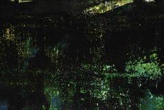 Textura pintada preta do metal com borrões, riscos e sparkles verdes fotografia de stock royalty free