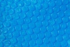 Textura plástica azul del abrigo de burbuja. Imágenes de archivo libres de regalías