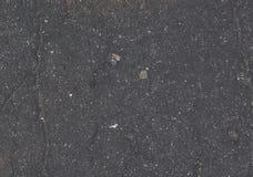 Textura plana del color del fondo agrietado gris del asfalto Imagen de archivo