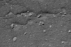 Textura plana del color del fondo agrietado gris del asfalto Imagen de archivo libre de regalías