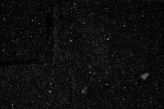 Textura plana del color del fondo agrietado negro del asfalto imágenes de archivo libres de regalías