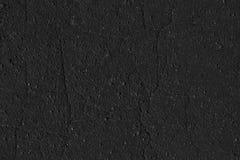 Textura plana del color del fondo agrietado negro del asfalto Fotos de archivo