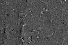 Textura plana del color del fondo agrietado negro del asfalto imagen de archivo libre de regalías