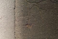 Textura plana del fondo agrietado negro del asfalto Imágenes de archivo libres de regalías
