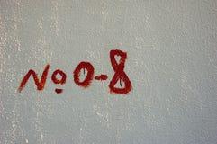 Textura pobre pintada da casa do número 8 Imagem de Stock