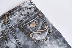 Textura preta das calças de brim do vintage da sarja de Nimes com fim do bolso acima foto de stock