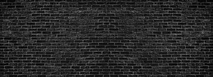 Textura preta larga da parede de tijolo - obscuridade - fundo cinzento da alvenaria imagens de stock