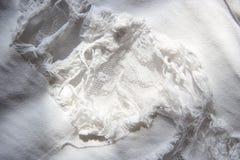 Textura quebrada calças de brim da tela da sarja de Nimes Imagem de Stock