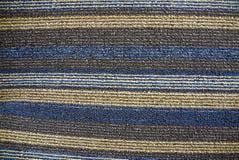 Textura rayada del paño de un pedazo de alfombra de lana Imagen de archivo libre de regalías