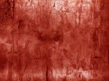 Textura roja asustadiza de la pared del grunge Fotos de archivo