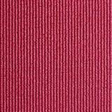 Textura roja de la estera de la yoga Imágenes de archivo libres de regalías