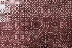 Textura roja del azulejo del mosaico en Lisboa Foto de archivo