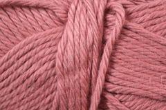 Textura roja en colores pastel del hilado foto de archivo