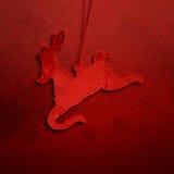 Textura roja vibrante de la Navidad con la decoración del reno imagen de archivo